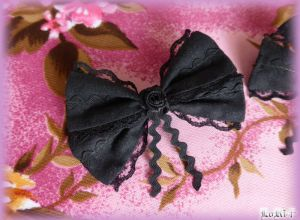 Black Flower Ribbon Pin